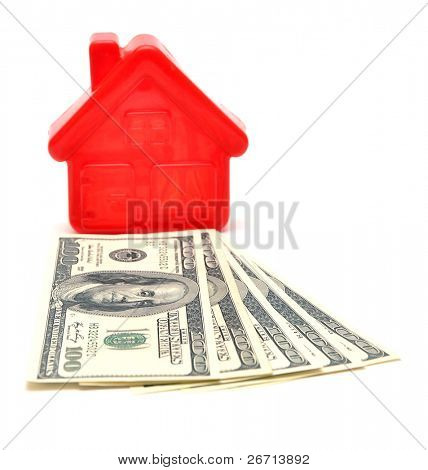 House on top of a money over white background
