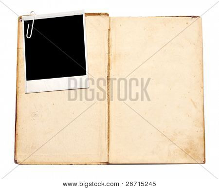 old book with vintage photo on white background