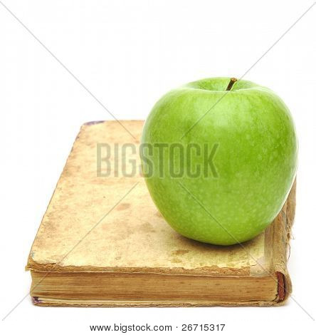 old book with apple isolated on white background