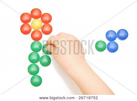 Hand and toy button on white background