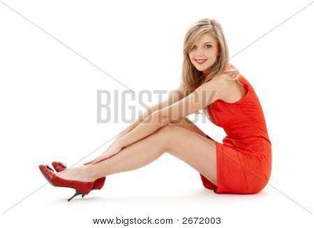 Sitting Girl In Red Dress