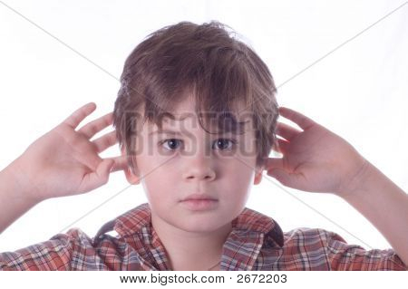 Little Boy Closes Ears