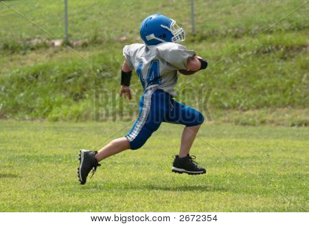 Youth Football Player Running For The Touchdown