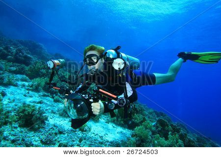 Scuba Diver with SLR camera in housing