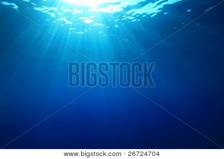 Sun rays in the blue ocean