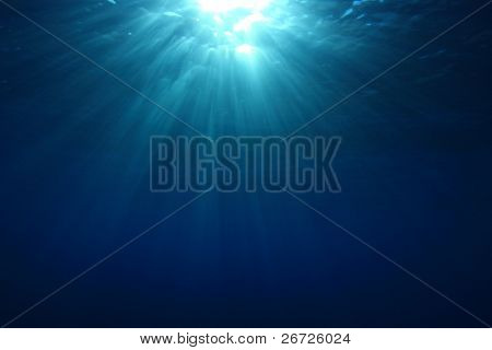 Abstract Underwater Background of Sunburst on Ocean Surface