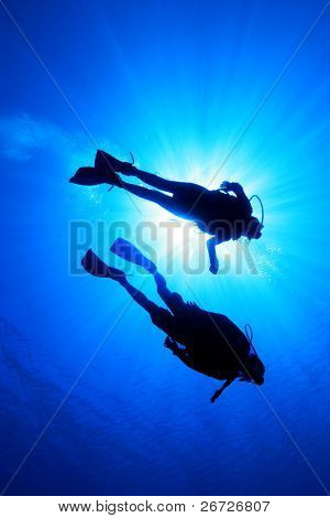 Couple Scuba Diving, silhouette and sunburst