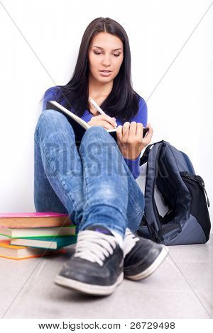 student girl  doing homework on break in school