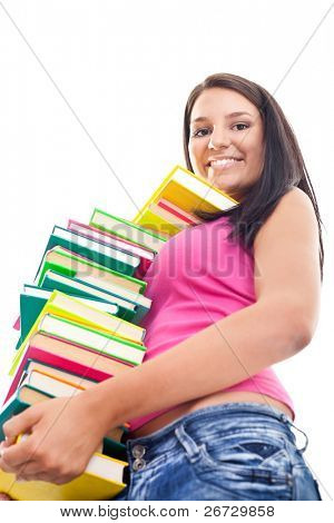 smiling girl holding big stack of color books , isolated on white background