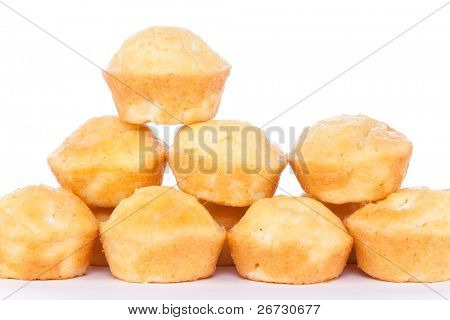 pile of corn muffins on white background