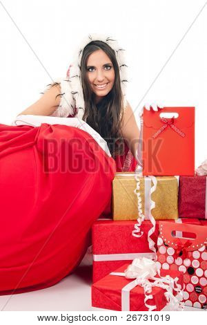 smiling  santa girl with lot of presets and big red bag, isolated on white background