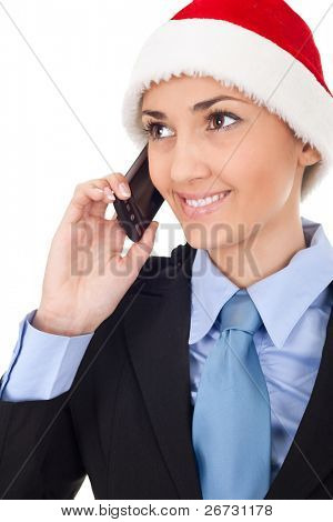 businesswoman in Santa hat talks on the phone, isolated on white background