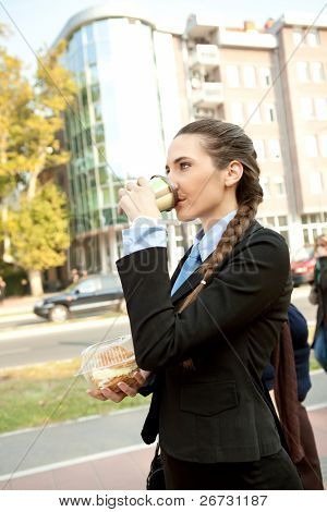 businesswoman drinking cafe on the way to work, overworked