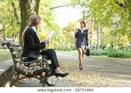 Businesspeople in city park on break