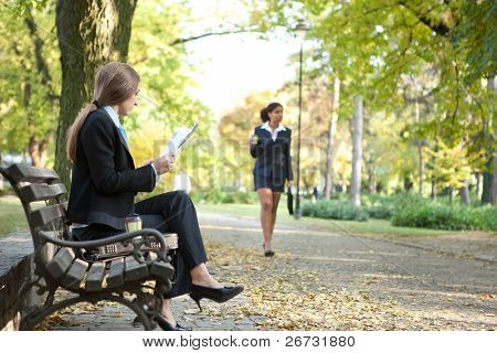Businesspeople spending free time in park
