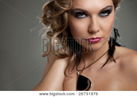 seductive woman with fashion make-up posing , close up