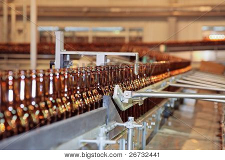 Conveyer line with many beer bottles