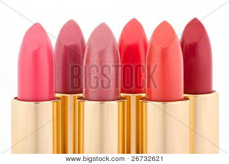 Multicolored color lipsticks arranged in two lines isolated on white, shallow depth of field