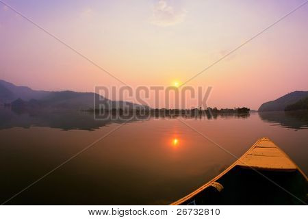 Beautiful sunrise landscape from boat view on Phewa lake, Pokhara, Nepal