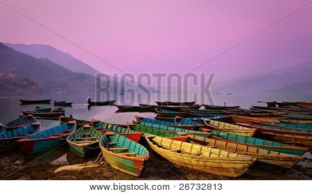 Beautiful twilight landscape with boats on Phewa lake, Pokhara, Nepal