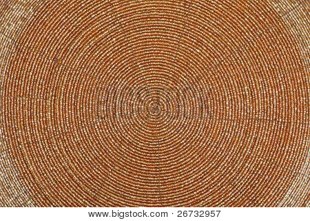 Golden beadwork texture background with round lines pattern