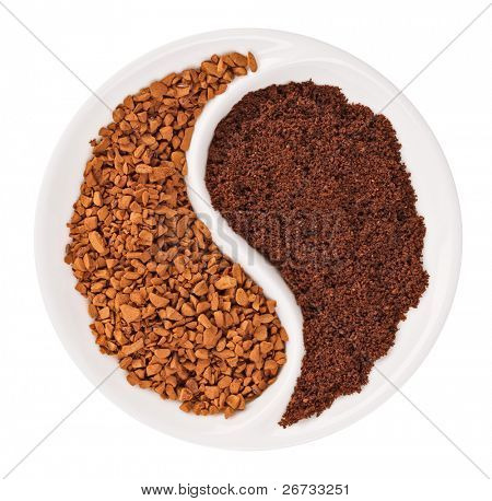 Natural ground coffee versus instant one in Yin Yang shaped plate, isolated on white