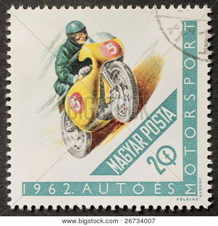 HUNGARY - CIRCA 1962: a stamp printed in Hungary shows illustration of a motoracer. Hungary, circa 1962