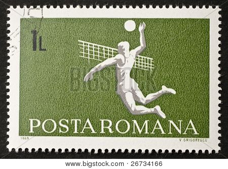 ROMANIA - CIRCA 1969: a stamp printed in Romania shows image of a volleyball slam over the net. Romania, circa 1969
