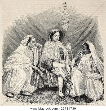 Antique illustration of Moorish women in home interior in Algiers. Original, from drawing of Janet-Lange, after photo of M. Moullin, published on L'Illustration, Journal Universel, Paris, 1860