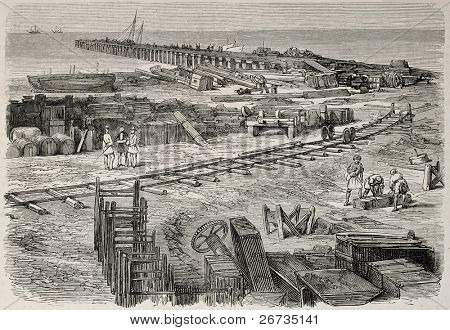 Antique illustration of railway station construction in Port Said, near unloading pier. Original, from drawing of Blanchard and Anastasi, published on L'Illustration, Journal Universel, Paris, 1860