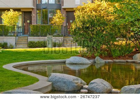Outdoor landscape garden with pond in North Vancouver, British Columbia, Canada. Sunset light.