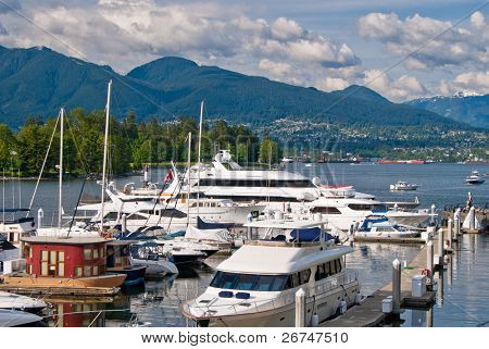 View over Coal Harbor marina and Stanley Park in Downtown of Vancouver, Canada.