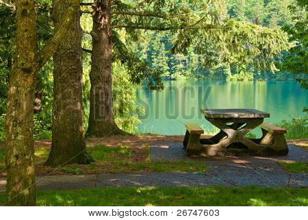 A picnic table with gorgeous view at Lake Of The Woods, British Columbia, Canada.