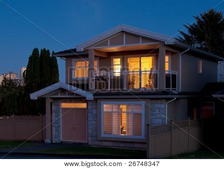A house in suburbs at dusk in Vancouver, Canada.