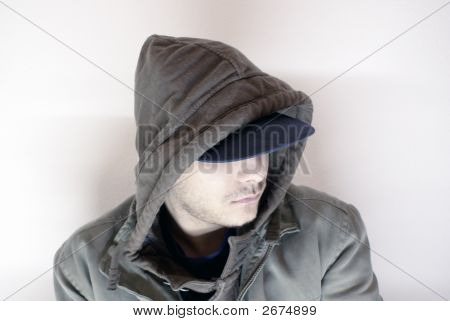 Young Gangster With Hood And Cap