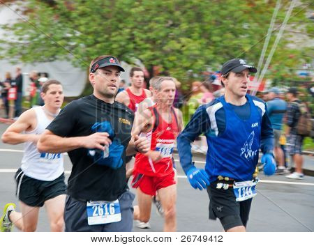 VICTORIA, BC, CANADA - OCTOBER 10: Runners Mike Yarish (Victoria, BC) and Russ Ladd (West Vancouver, BC) compete at the GoodLife Fitness Victoria Marathon October 10, 2010 in Victoria, BC, Canada.
