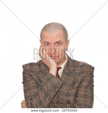 A businessman holding his head. Isolated on white. Body language. Boredom. Tedium.