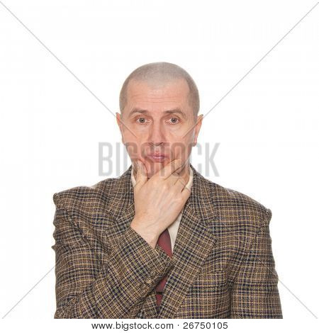 A businessman rubbing his chin. Isolated on white. Body language. Indecision. Uncertainty.