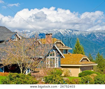 Fragment of a nice house over fantastic snow mountain view in North Vancouver, Canada.