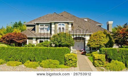 Luxury house with gorgeous outdoor landscape on sunny summer day in Vancouver, Canada.