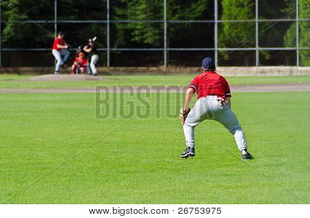 Baseball players playing the sport they love at a small stadium of the minor leagues