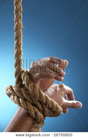 hand being tight by rope asking for help