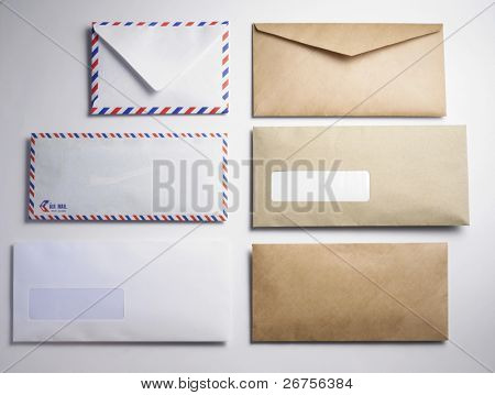few different type of the envelope on thew plain background