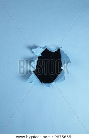 hole on the blue color paper