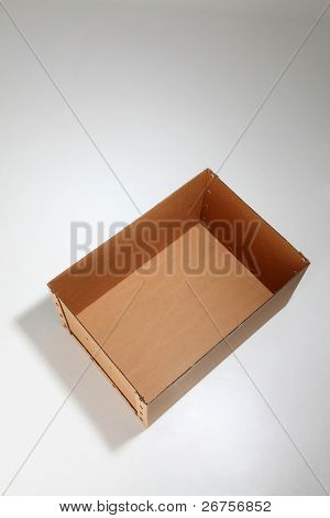 empty brown card box open on the plain background