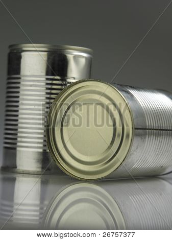 two aluminum can with reflection