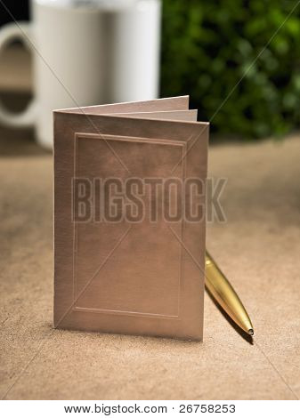 blank card on the table top with mug