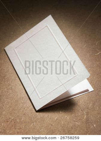 close up of the blank card on the brown table