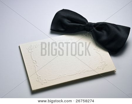 bow tie on top of the blank card