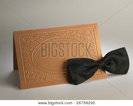 bow tie and the blank card on the plain background